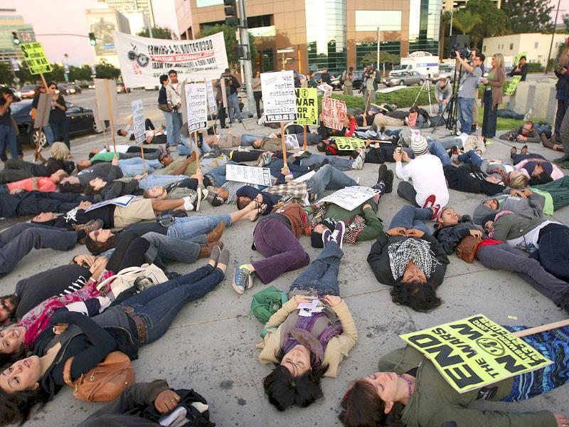 Demonstrators lie on the ground during a die-in protest against US involvement in the war in Afghanistan, on the 10th anniversary of the war in Los Angeles, California.