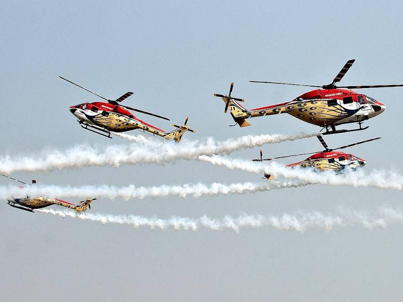 Advanced Light Helicopters (ALH) of the Indian Air Force's Sarang team perform during the Air Force Day parade at Air Force Station Hindon in Ghaziabad on the outskirts of New Delhi.