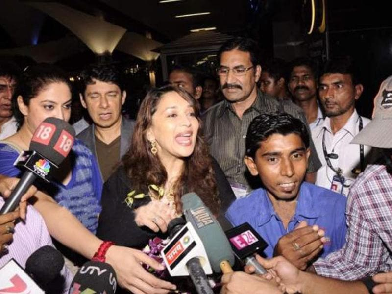 Madhuri Dixit interacts with media as she lands at Mumbai International airport.
