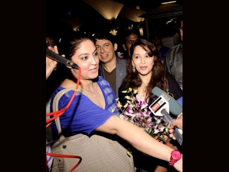 Madhuri Dixit looks cheerful as she interacts with her fans and media.