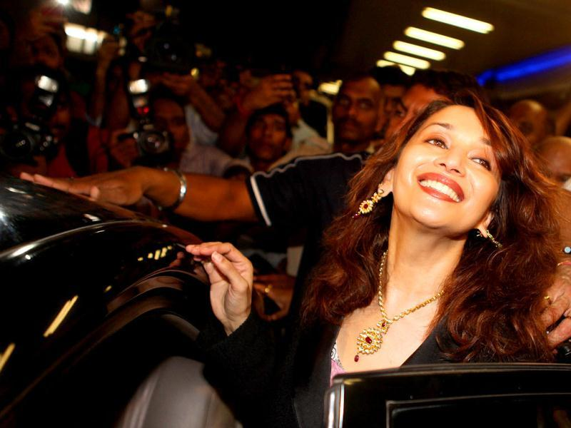 Madhuri Dixit is all smiles as she steps into her car.