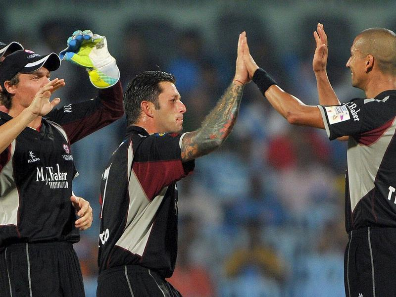 Somerset bowler Alfonso Thomas (R) celebrates the dismissal of Mumbai Indians batsman Kieron Pollard with his team mates during the Champions League Twenty20 cricket semi final match in Chennai.