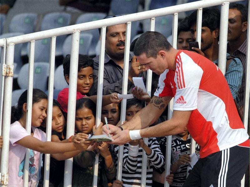 England's Kevin Pietersen signing autographs for young fans during a practice match against Hyderabad Cricket Association (HCA) XI at Rajiv Gandhi International Stadium, Uppal in Hyderabad.