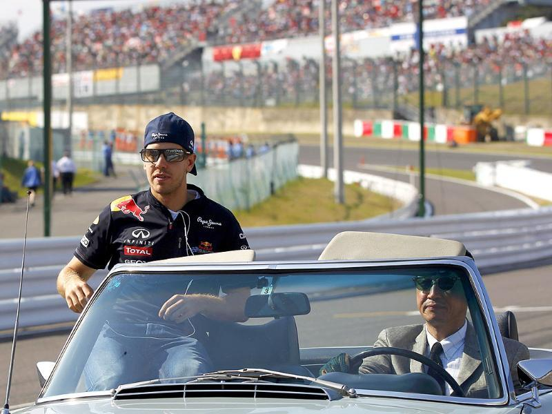 Red Bull Formula One driver Sebastian Vettel of Germany takes part in the drivers parade ahead of the Japanese F1 Grand Prix at the Suzuka circuit.