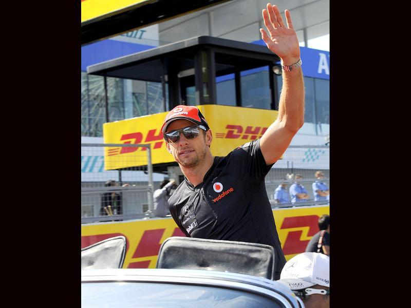McLaren-Mercedes driver Jenson Button of Britain waves during the drivers' parade prior to the Formula One's Japanese Grand Prix at Suzuka.