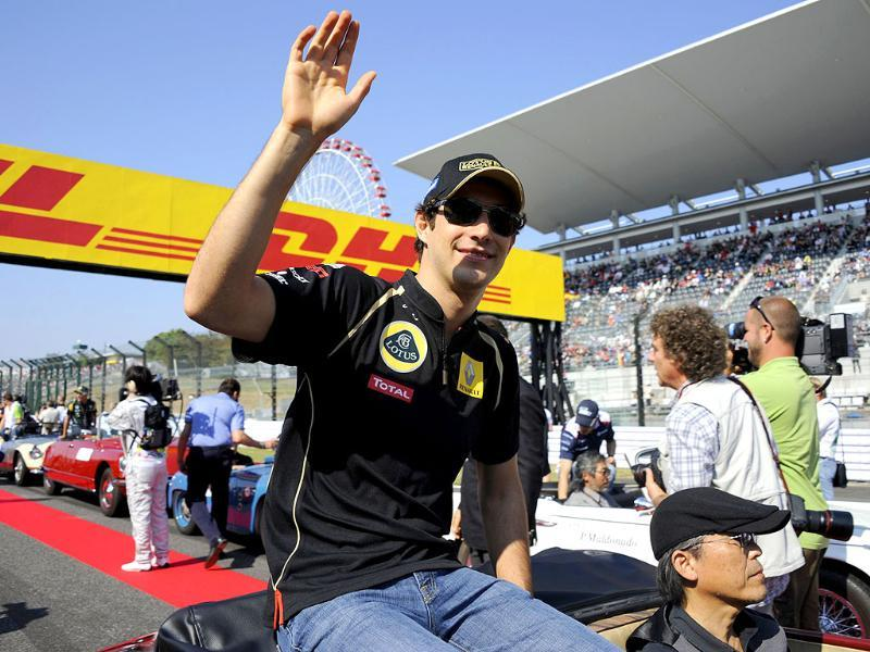 Lotus-Renault driver Bruno Senna of Brazil waves during the drivers' parade prior to the Formula One's Japanese Grand Prix at Suzuka.