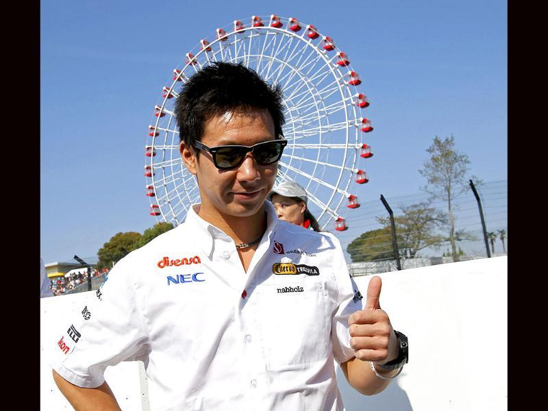 Sauber Formula One driver Kamui Kobayashi of Japan poses for photographers ahead of the Japanese F1 Grand Prix at the Suzuka circuit.