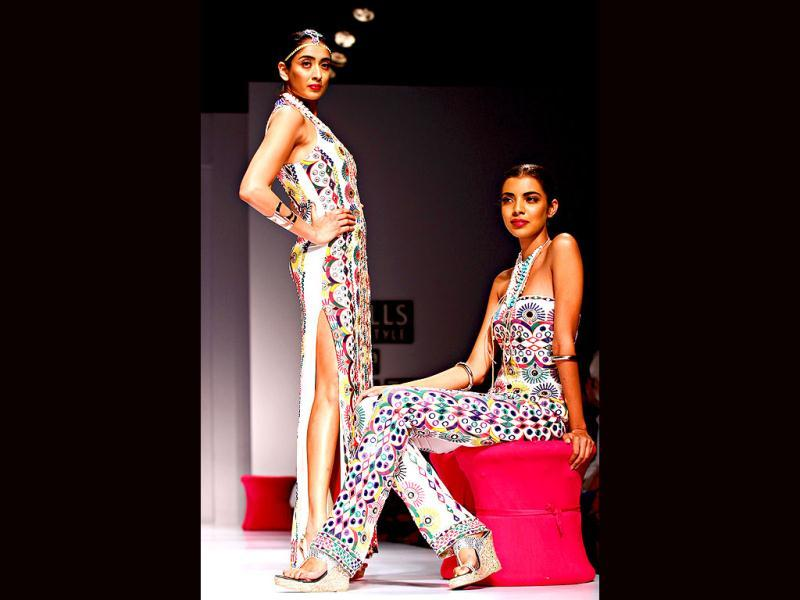 Models strike a pose in designer outfits by Malini Ramani.