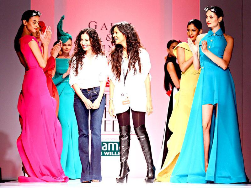 Gauri and Nainika take a final bow after their fashion show.