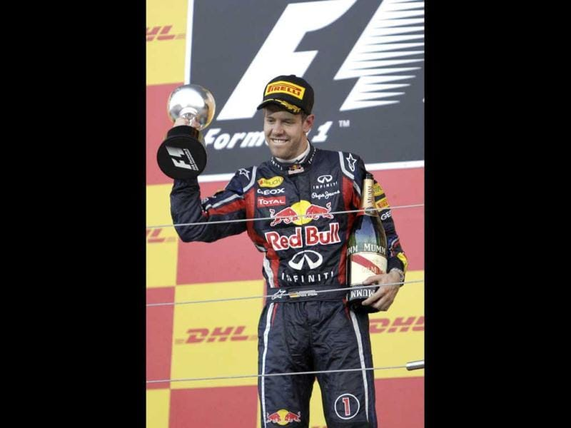 Red Bull driver Sebastian Vettel of Germany holds his trophy after finishing third in the Japanese Grand Prix to clinch the Formula One drivers championship in Suzuka, central Japan.