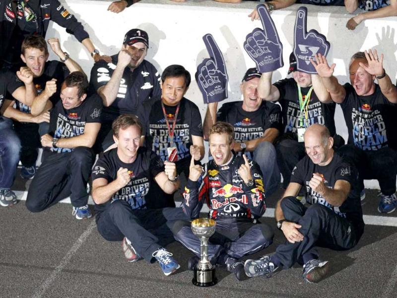 Red Bull Formula One driver Sebastian Vettel of Germany (C) celebrates with crew members winning the world championship after finishing third in the Japanese F1 Grand Prix at the Suzuka circuit.