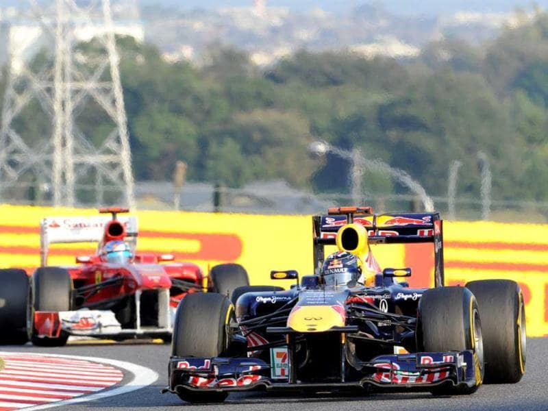 Red Bull-Renault driver Sebastian Vettel of Germany (R) leads Ferrari driver Fernando Alonso of Spain during the Formula One's Japanese Grand Prix at Suzuka.