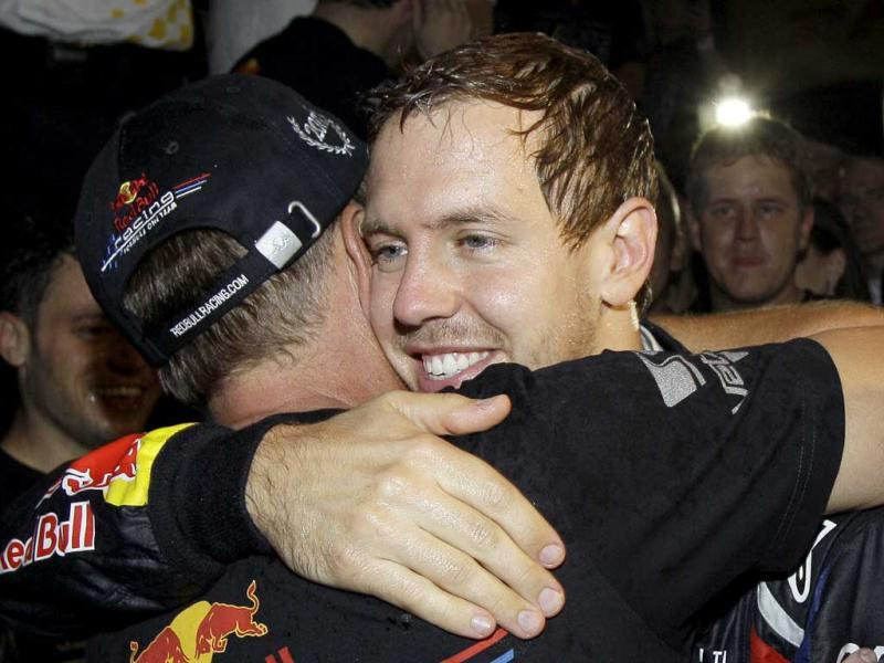Red Bull driver Sebastian Vettel of Germany, right, celebrates with team members after taking third place in the Japanese Grand Prix to win the Formula One World Championship at the Suzuka Circuit in Suzuka, central Japan.