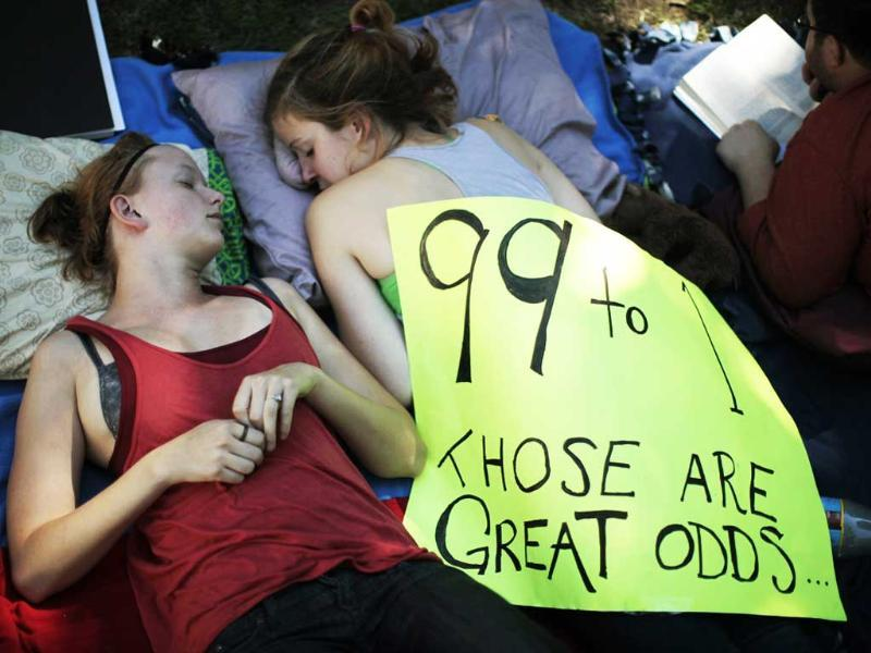 Erin Muhs and Kinsey Diment, rest at the Occupy LA protest camp in Los Angeles, California.