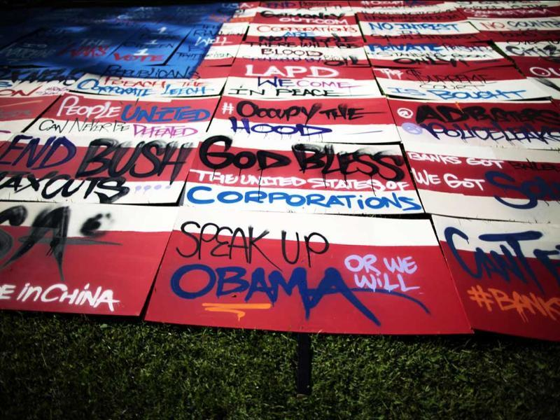 A US flag pieced together with graffiti signs designed by street artist Saber is displayed at the Occupy LA protest camp in Los Angeles, California.