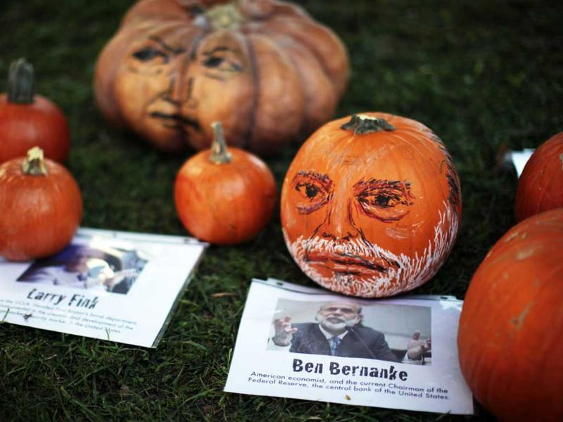 Pumpkins decorated with the faces of bankers are displayed at the Occupy LA protest camp in Los Angeles, California.