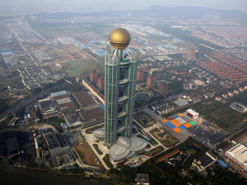 The newly inaugurated skyscraper tower of Huaxi village is seen in Huaxi village, Jiangsu province. Huaxi, also known as China's richest village, celebrates its 50th anniversary with the inauguration of a massive 328-meters (1,076 feet) high skyscraper that screams for attention from its lowly skyline.