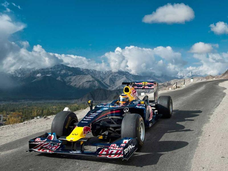 In this handout photo released on October 11, 2011, Red Bull Racing driver Neel Jani drives the Red Bull Racing Formula One show car on the world's highest motorable road at 18,380 feet on the Khardung-La pass in Leh region.