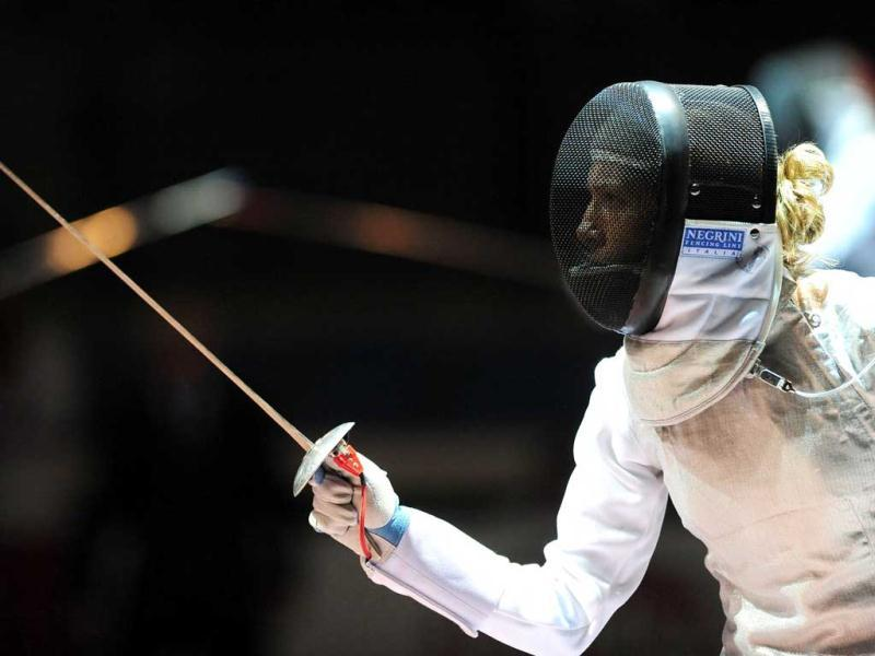 Italy's Valentina Vezzali fights against Britain's Sophie Troiano during the Women's Foil competition at the 2011 World Fencing Championships in Catania.