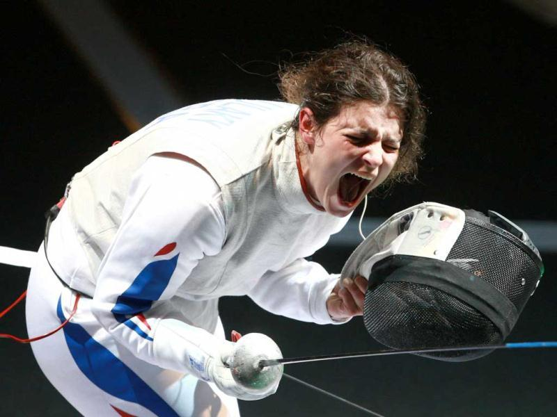 France's Virginie Ujlaky reacts after defeating Italy's Arianna Errigo during the Women's Foil competition during the 2011 World Fencing Championships in Catania.