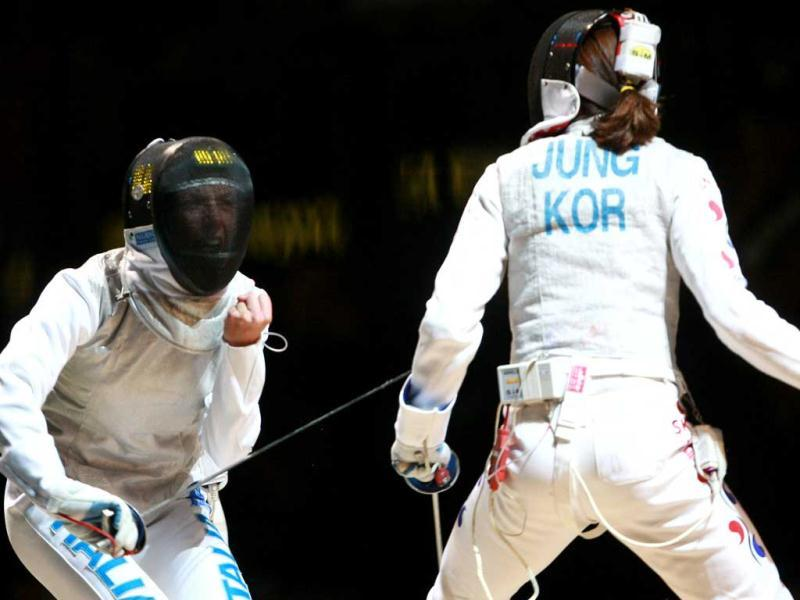 Italy's Valentina Vezzali (L) reacts against Korea's Jung Gil Ok during the Women's Foil competition during the 2011 World Fencing Championships in Catania.