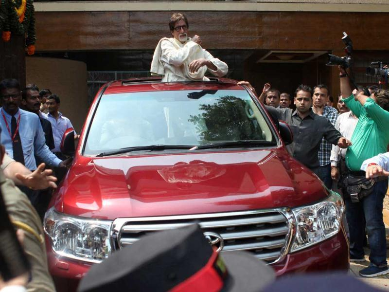 Bollywood star Amitabh Bachchan celebrates his 69th birthday outside his Bungalow.