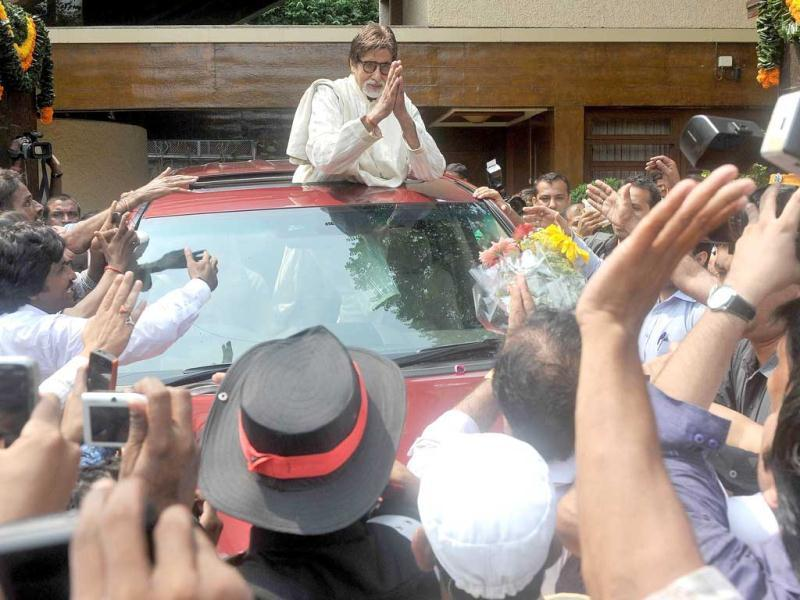 Bollywood's most loved star greets fans outside his home on his birthday.