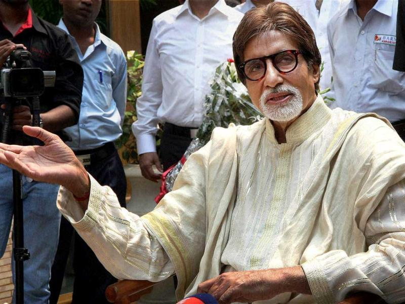 Amitabh Bachchan greets fans waiting to wish him well on birthday in Mumbai.