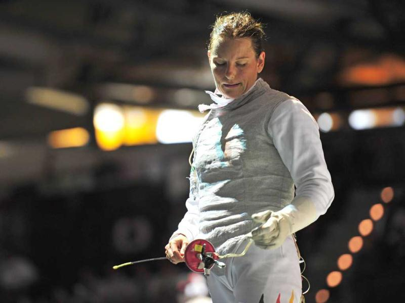 Germany's Anja Schache reacts during her fight against US Lee Kiefer at the Women's Foil competition at the 2011 World Fencing Championships in Catania.