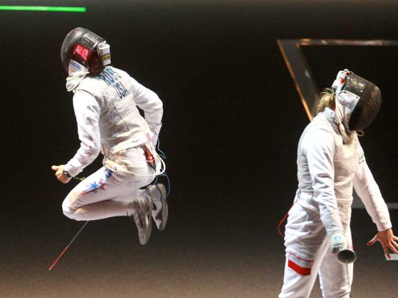 US Nicole Ross (L) celebrates after defeating Poland's Sylwia Gruchala during the Women's Foil competition at the 2011 World Fencing Championships in Catania.