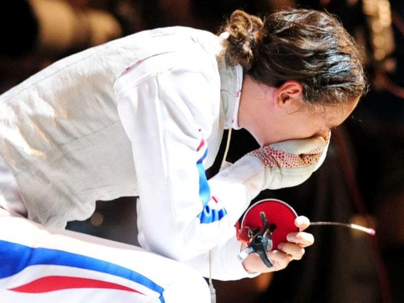 France's Corinne Maitrejean reacts after being defeated by Italy's Valentina Vezzali during the quarterfinals of the Women's Foil competition at the 2011 World Fencing Championships in Catania.