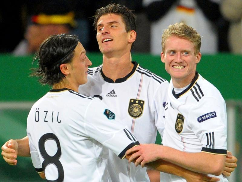 (LtoR) The three German scorers Mesut Oezil, Mario Gomez and André Schuerrle celebrate the German national football team's third goal during the UEFA Euro 2012 qualifying match against Belgium in Duesseldorf.