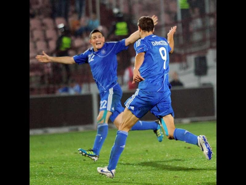 Greece's Angelos Charisteas (R) and Kyriakos Papadopoulos celebrate a goal during the UEFA Euro 2012 group F football match against Georgia in Tbilisi.