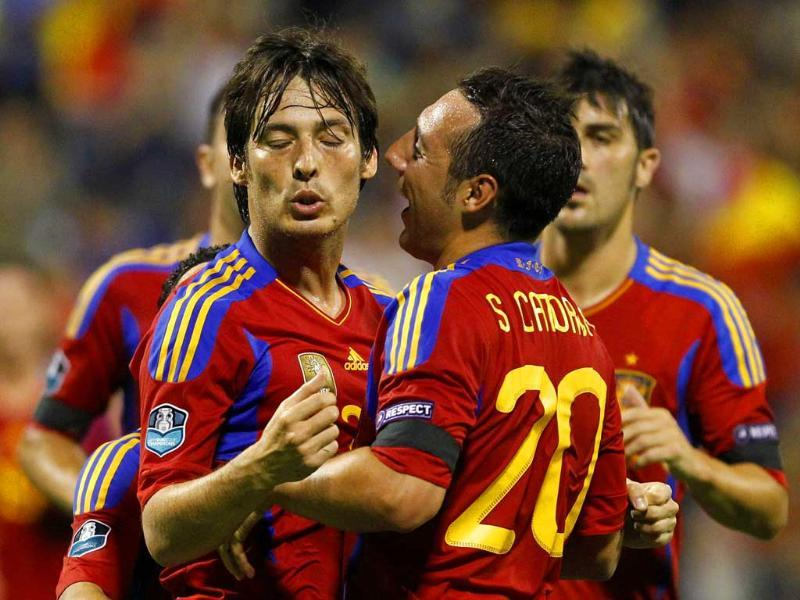 Spain's David Silva celebrates with teammates after he scored against Scotland during their Euro 2012 qualifying Group I soccer match at the Perez Rico Stadium in Alicante.