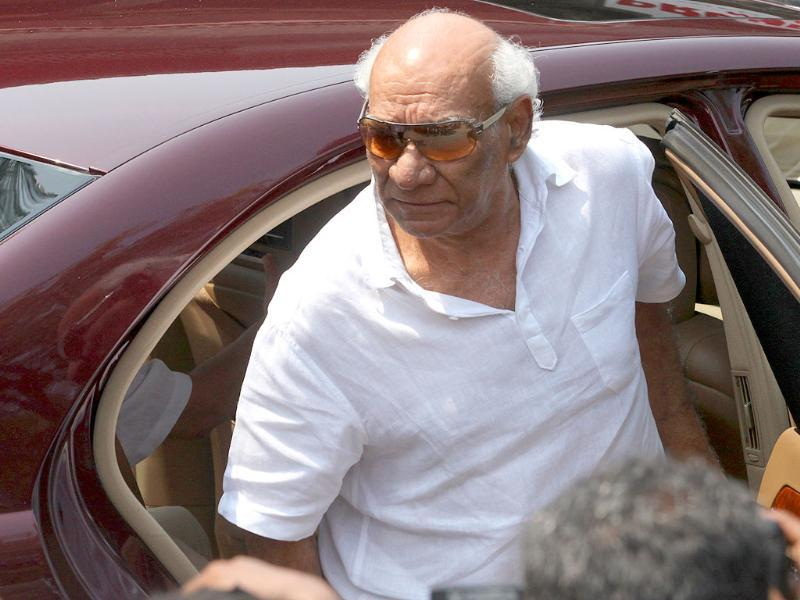 Filmmaker Yash Chopra arrives to pay his condolences.