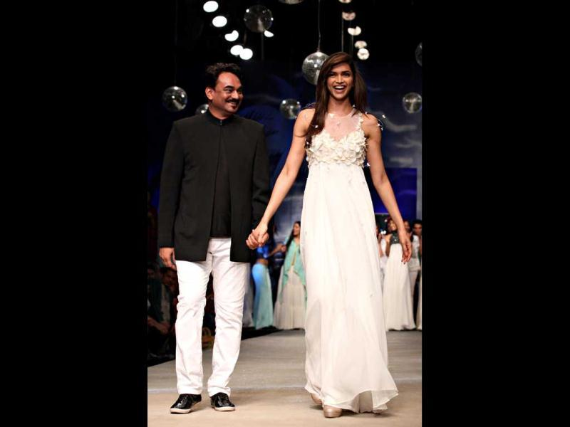 Deepika Padukone walks the ramp with designer Wendell Rodricks.