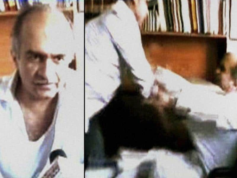 A combo TV Grab courtesy Times Now- Supreme Court lawyer-activist Prashant Bhushan being roughed up at his chamber, in New Delhi