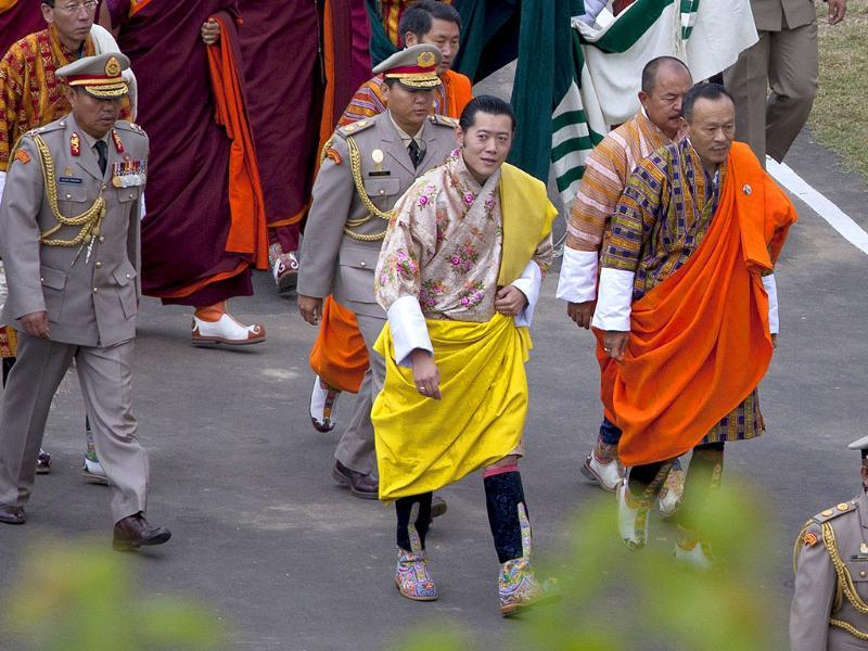 King of Bhutan Jigme Khesar Namgyel Wangchuck (CL) and future queen Jetsun Pema (CR) stand together during their marriage ceremony in the main courtyard of the 17th-century fortified monastery or dzong in Punakha.