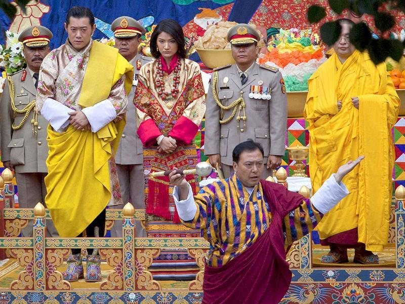 King Jigme Khesar Namgyel Wangchuck (L) and his bride Jetsun Pema take part in a purification ceremony at the Punkaha Dzong during their wedding ceremony in Bhutan's ancient capital Punakha.