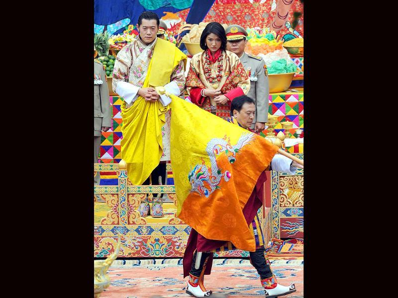 King of Bhutan and future queen stand together during their marriage ceremony in the main courtyard of the 17th-century fortified monastery or dzong in Punakha.