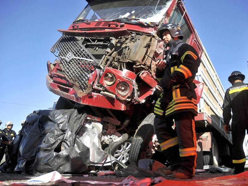 Firefighters work at the scene of a multi-vehicle pile-up on a highway in Casablanca, about 43 miles or 70 kilometers from Santiago, Chile.
