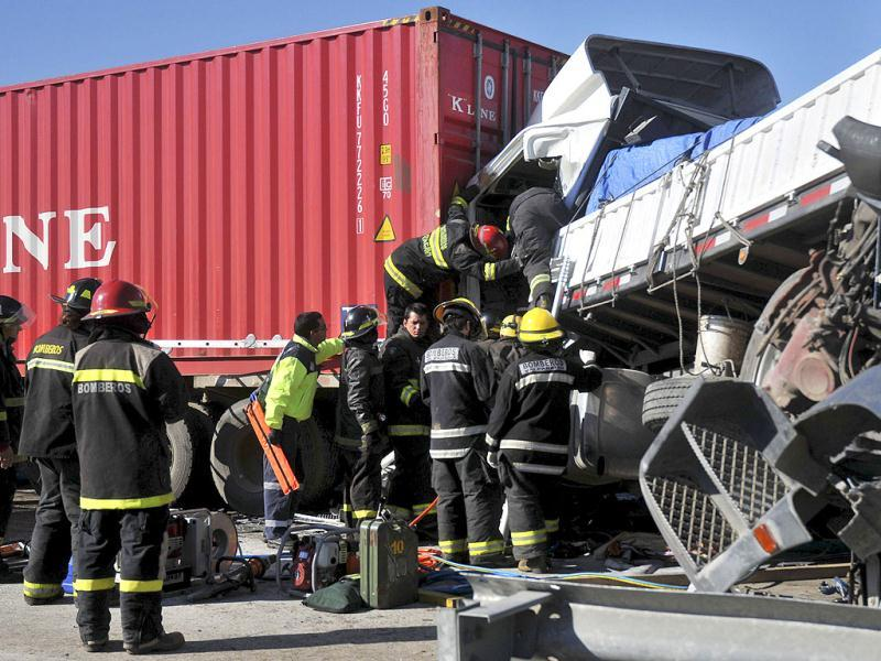 Firefighters work to rescue a driver at the scene of a multi-vehicle pile-up on a highway in Casablanca, about 43 miles or 70 kilometers from Santiago, Chile.