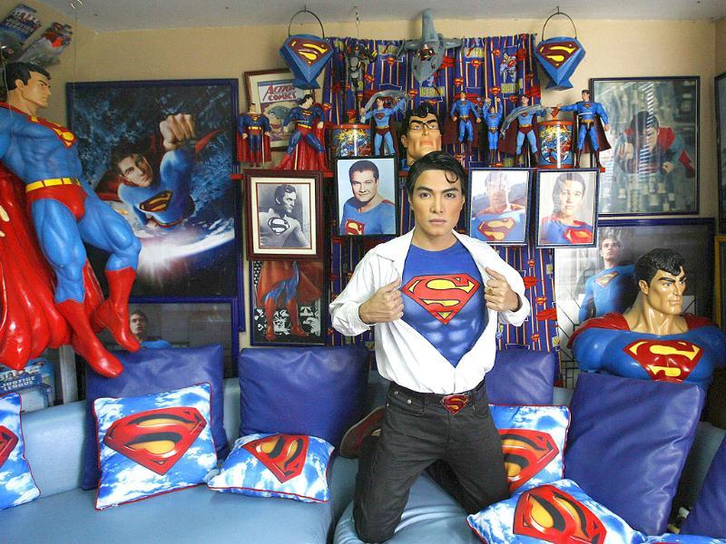 Herbert Chavez poses with his Superman memorabilia inside his house in Calamba Laguna, south of Manila.