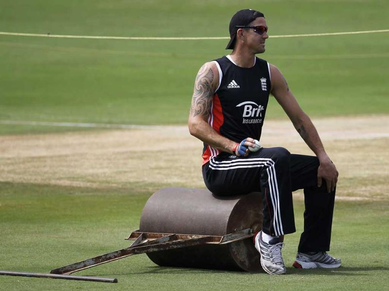 England's Kevin Pietersen sits on a ground roller during a practice session ahead of their first one-day international cricket match against India in Hyderabad.
