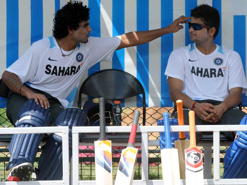 Indian cricketers Ravindra Jadeja (L) and Suresh Raina (R) chat during a practice session at Rajiv Gandhi International Stadium in Hyderabad.
