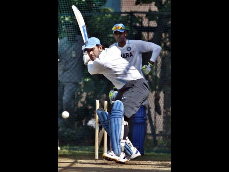 India's cricket captain Mahendra Singh Dhoni bats in the nets during a practice session in Hyderabad.