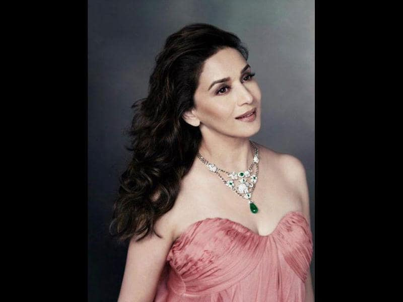 Madhuri looks radiant as she dons a neckpiece from Emeralds for Elephants jewellery.