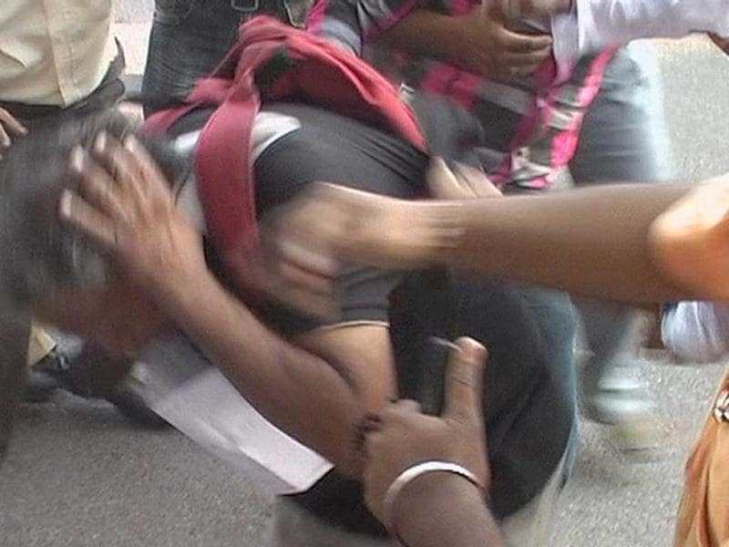 TV grab of the attack on Anna supporters by Sri Ram Sene activists outside the Patiala House court in New Delhi.