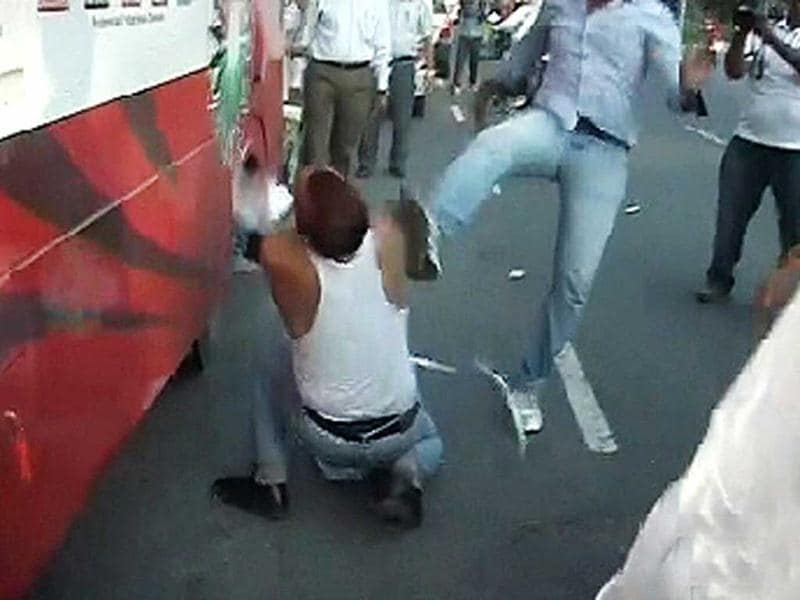 A man gets kicked in this TV grab of the scuffle between Sri Ram Sene activists and Anna Hazare's supporters outside Patiala House court in New Delhi.