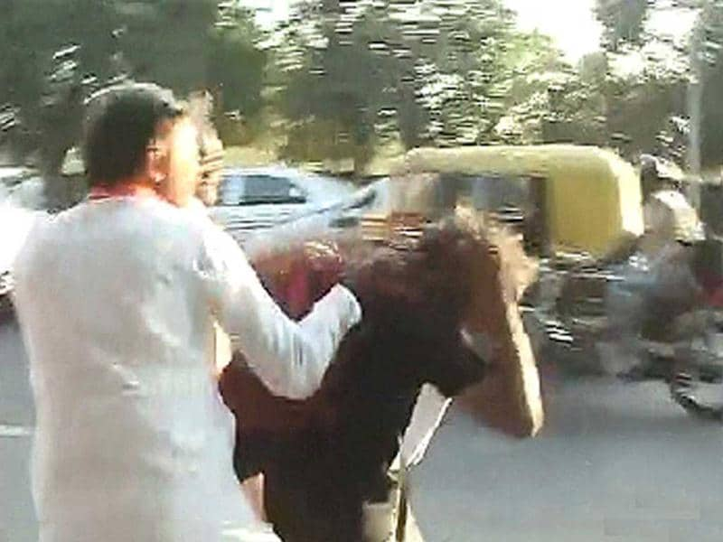TV grab of the attack on Anna supporters by Sri Ram Sene activists outside the Patiala House courts in New Delhi.